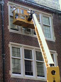 Cleaning 3rd floor windows is no problem with our Crowe hydraulic lift